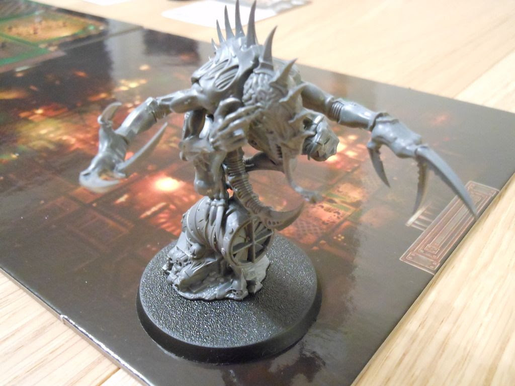 The genestealer patriarch from the Deathwatch: Overkill board game.