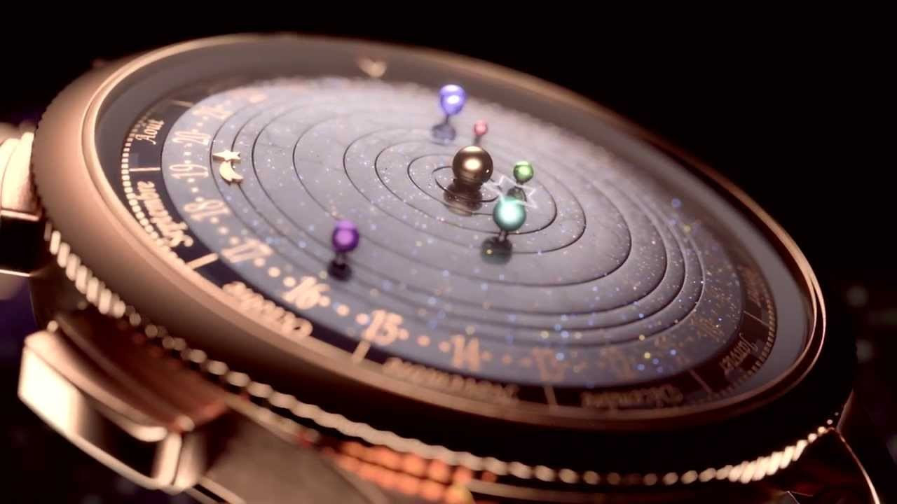 uhohmarty:  A gorgeous watch that has the planets visible from earth rotating in real-time.