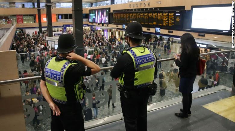 British Transport Police monitor activity Friday at Euston Station in London.