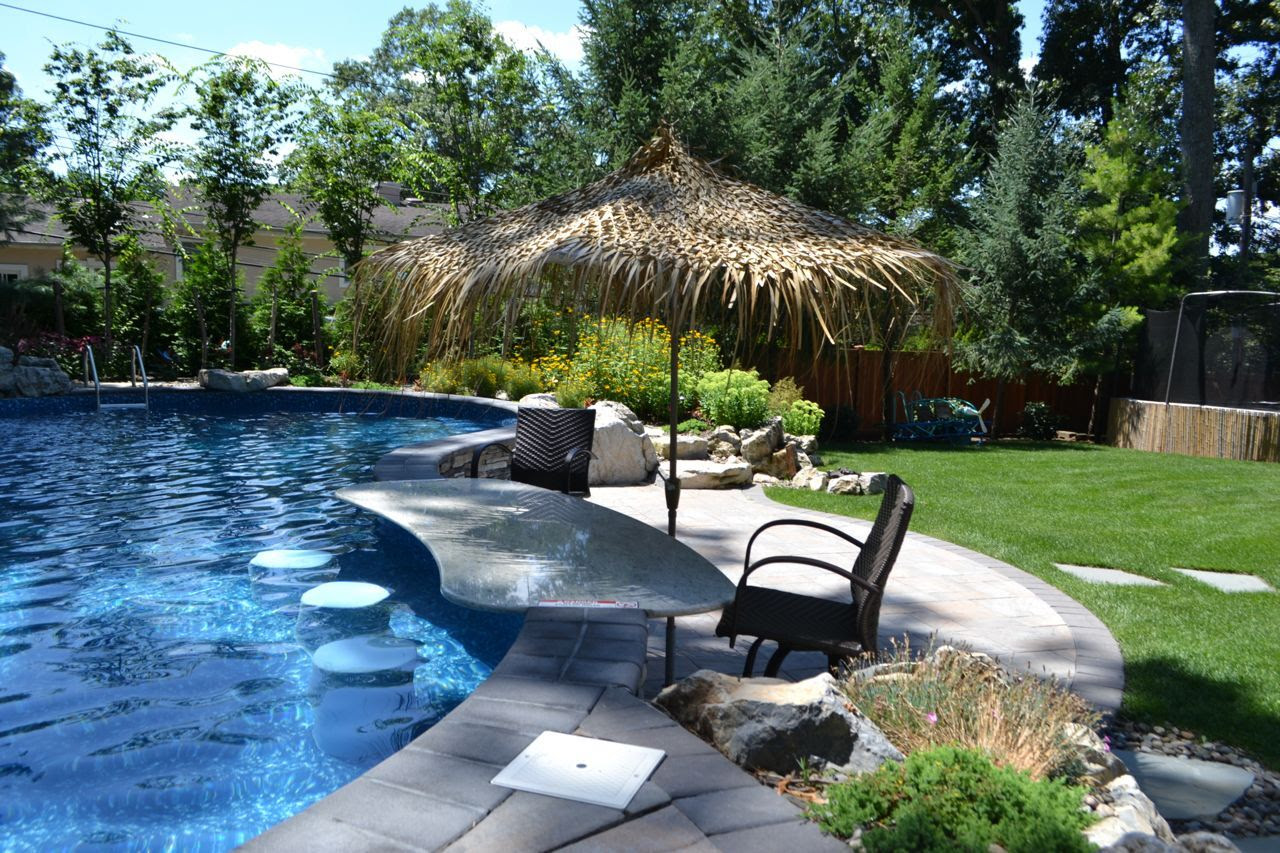 Small Sloped Yard: Fitting a Pool and Other Outdoor Living