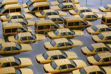One of the many lesser effects of Hurricane Sandy: taxis buried in water up to their headlights