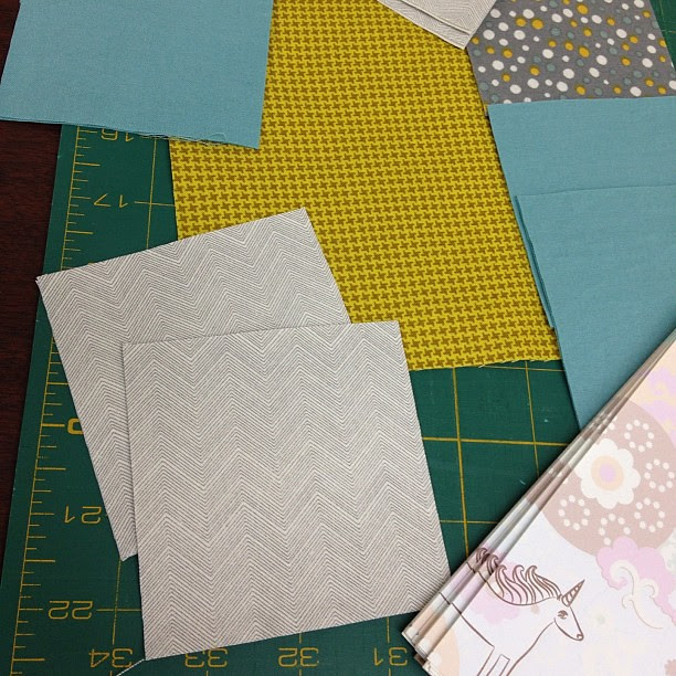 Pieces cut for my first-ever quilt block! (with @yummygoods for note-taking) It was a straight split on which grouping folks liked. I ended up going with the left one in the previous picture. Ready to start sewing. #quilting