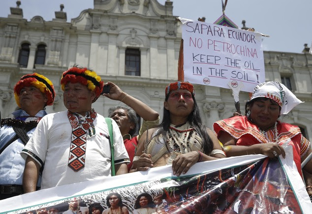 """Indian from Ecuador participate in a march in """"Defense of Mother Earth"""" in Lima, Peru, Wednesday, Dec. 10, 2014. Thousands marched in support of Mother Earth..."""