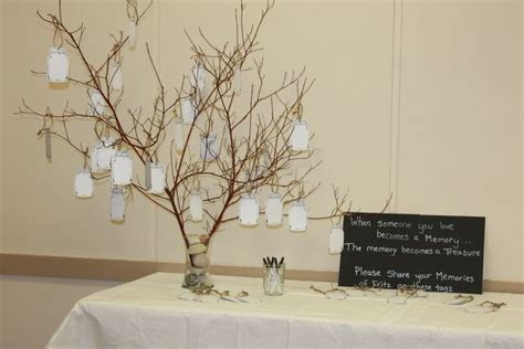 funeral ideas   Memory tree with tags for guests to write