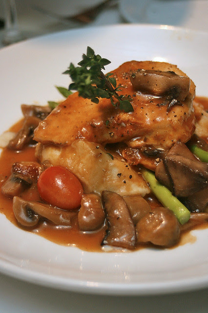 Chicken Marsala - sauteed chicken scallopine nestled in Marsala mushroom sauce, served with buttery mashed potatoes and fresh vegetables