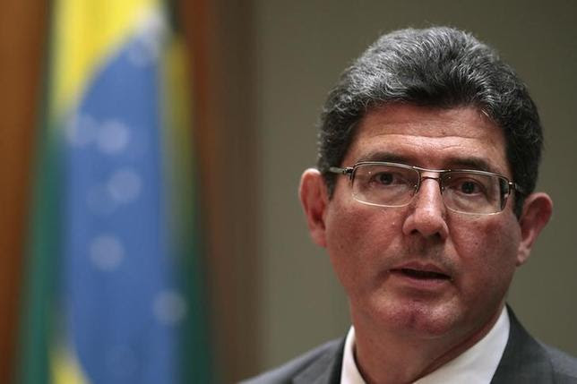 Brazil's Finance Minister Joaquim Levy reacts during a news conference in Brasilia February 27, 2015. REUTERS/Ueslei Marcelino