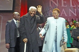 Former South African President Nelson Mandela with his wife Graca Machel at a 90th birthday gathering in South Africa. by Pan-African News Wire File Photos