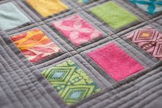 yummy-lious colors & quilting. Love this gray background, very popular lately. Must try ths on next scrappy quilt