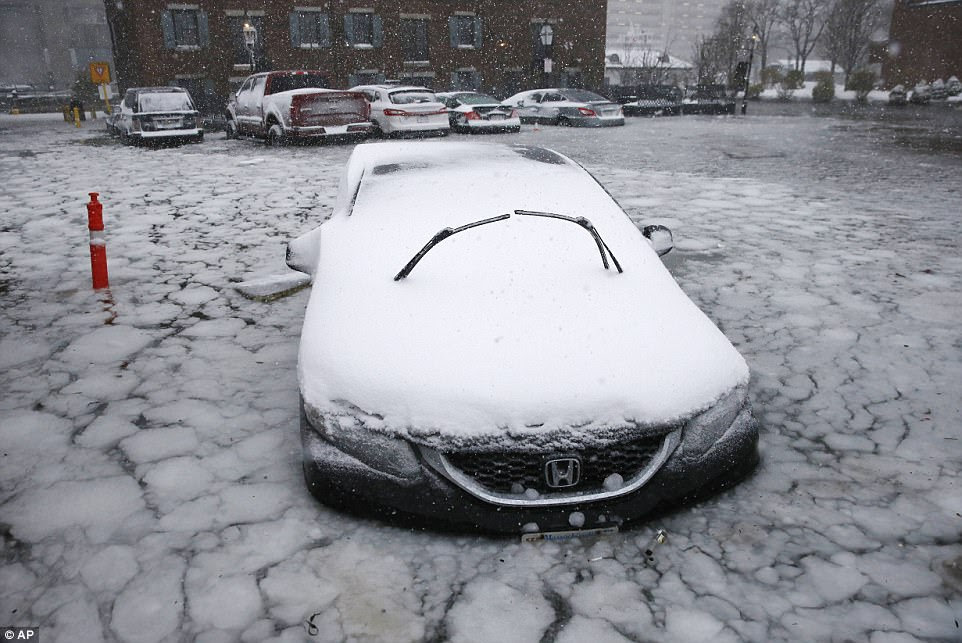While most people have kept their eyes on Winter Storm Grayson, the National Weather Service has predicted 'life-threatening' cold overnight Friday and Saturday for much of the Northeast. Above, a car in floodwaters in Boston on Thursday