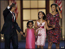Barack Obama and his wife, Michelle, hold hands with their two daughters, Malia (second right) and Sasha