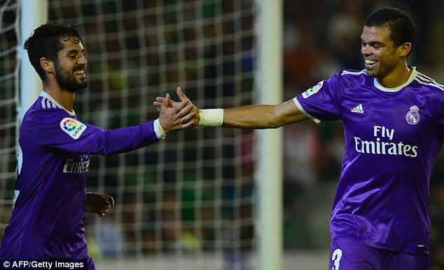 Isco (left) shares a high five with Pepe after the two combined for Real's fourth goal