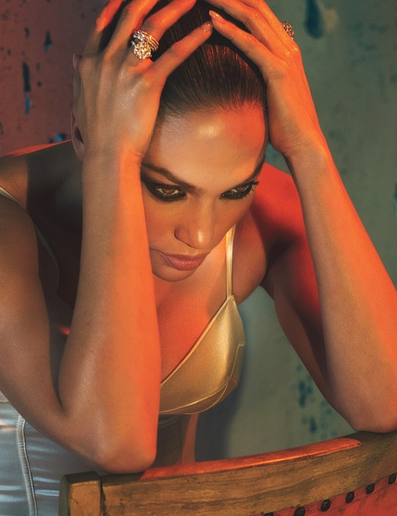 Jennifer Lopez poses in Fleur du Mal bodysuit with jewelry from Piaget and Nirav Modi