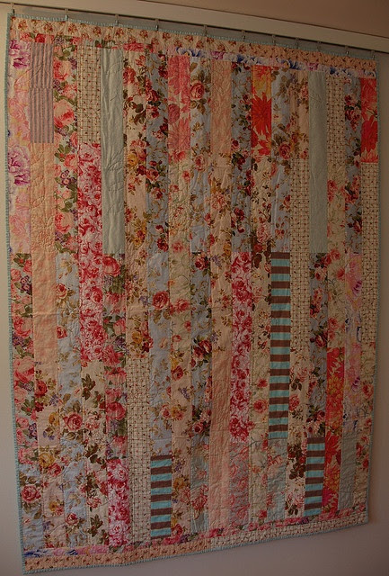 Simple quilts made of various sizes of rectangles; love the mix of floral prints with the stripe