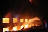 Firefighters try to extinguish a fire in a garment factory north of Dhaka on November 24. Tuba Group, the parent company of the Tazreen Fashion factory, said on its website that the factory opened in 2009 and employed 1,630 workers making polo shirts, T-shirts and jackets
