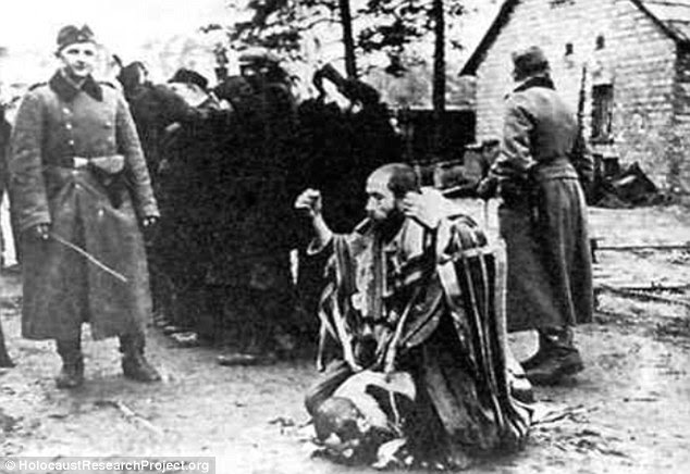 Humiliated: Gross said, 'Non-Jews were subjected to a horrible degree of violence by the Nazi occupiers and there is a very prominent phenomenon of resistance on a unique scale.' Pictured , a Jewish man humiliated by a Nazi guard