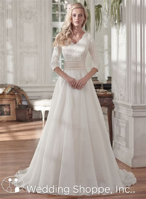 A modest lace wedding dress with 3/4 length sleeves