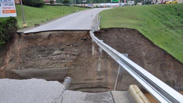 Damage to culvert crossing at Elkview Crossings Mall after heavy rain on West Virginia on 24 June