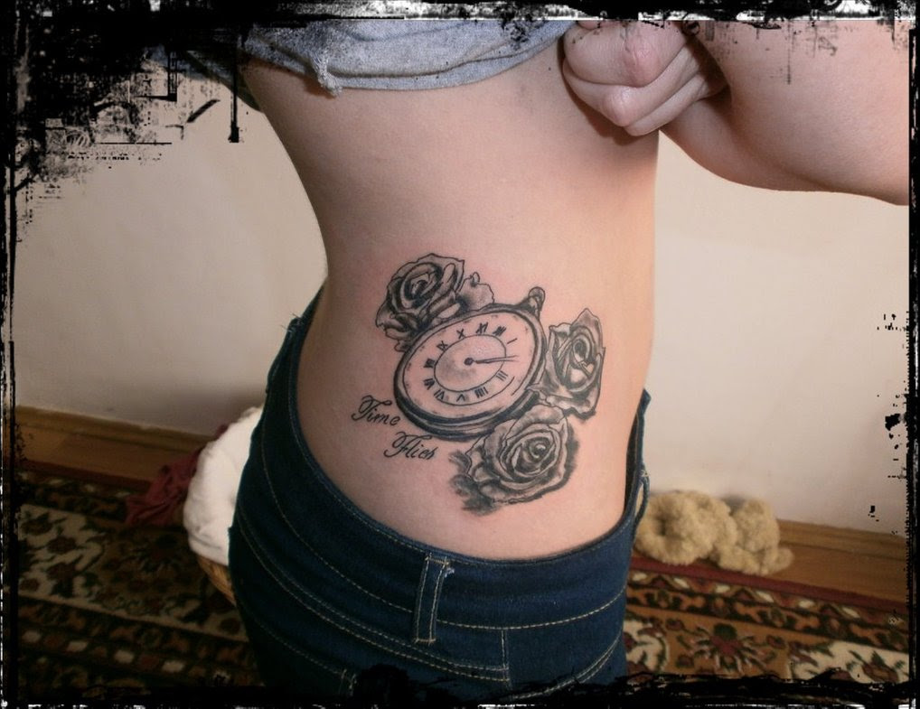 Side Rib Flowers And Pocket Watch Tattoo For Girls