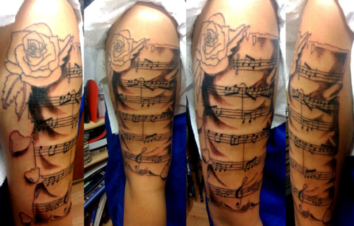 Rose And Piano Music Notes Tattoo On Half Sleeve