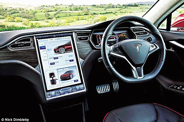 The Tesla Model S dashboard, shown, allows users to select and alter different features of the car