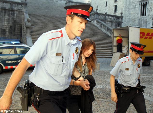Appalling case: Smith is led into the court in Girona, Spain, for the final day of her trial