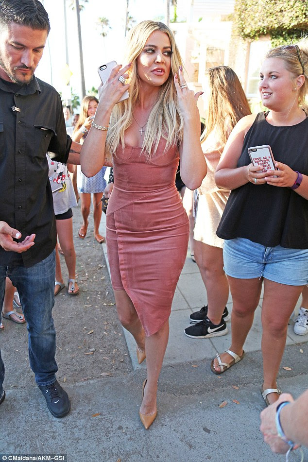 Looking great! Khloe, 32, was looking incredible, with her slimmed down figure on show in a pale pink outfit