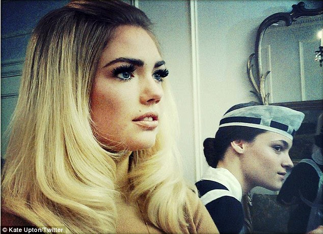 Just like Bardot: Make-up artist Jeanine Lobell gave the bikini model thick black eyebrows, thick false eyelashes, and partially-up tousled hair for the 1960's inspired shoot