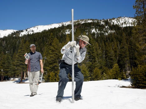 Frank Gehrke, chief of the California Cooperative Snow Surveys Program for the Department of Water Resources, right, plunges the snow survey tube into the snow pack, as DWR's Wes McCandless looks on during the snow survey at Phillips Station, Monday, May 1, 2017, near Echo Summit, Calif. (AP Photo/Rich Pedroncelli)