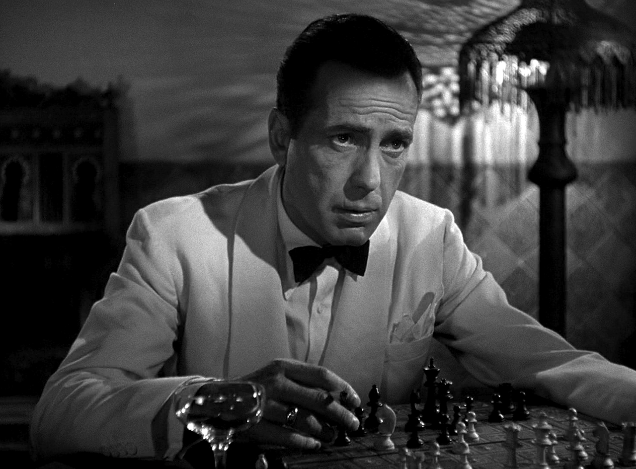 You Must Remember This. Humphrey Bogart and the double-breasted, roll lapel resort dinner jacket, 1942.