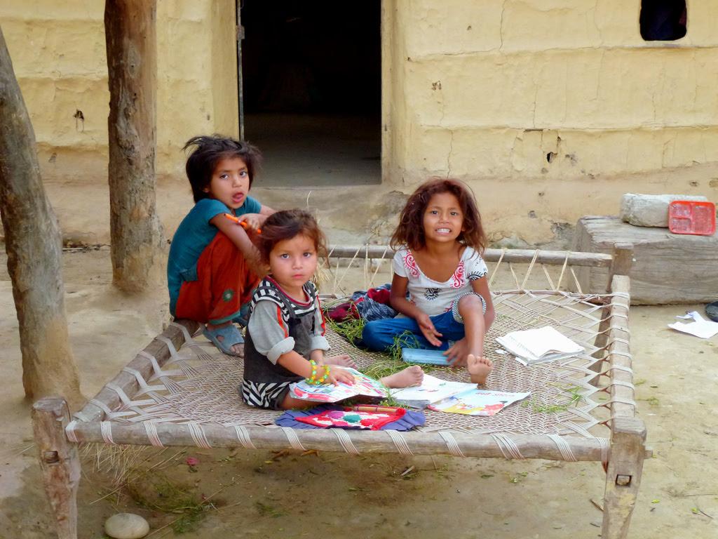 Kids playing outside their house, Thakudwara     Bardia Eco ...