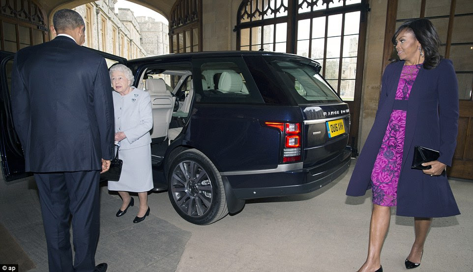 Face-to-face: The Queen, the President and Mrs Obama all sat in a Range Rover being driven by Prince Philip to the castle