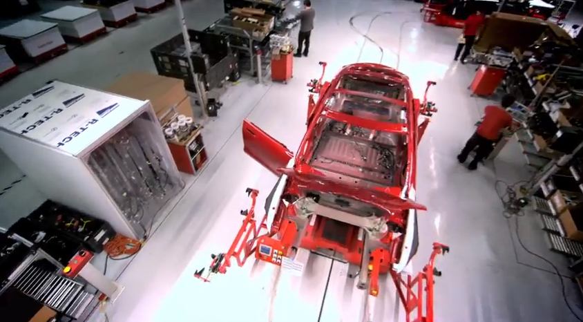 The painted body is then sent to General Assembly, where it is carried down an assembly line by robots that follow a magnetic pattern inlaid in the floor.