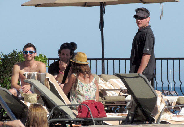 Vanessa Minnillo and Nick Lechey hang out by the pool of their Mexican hotel after attending a friends beach wedding.