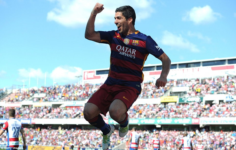 Luis Suarez leaps into the air to celebrate doubling Barcelona's lead as they secured a second La Liga title in a row on Saturday