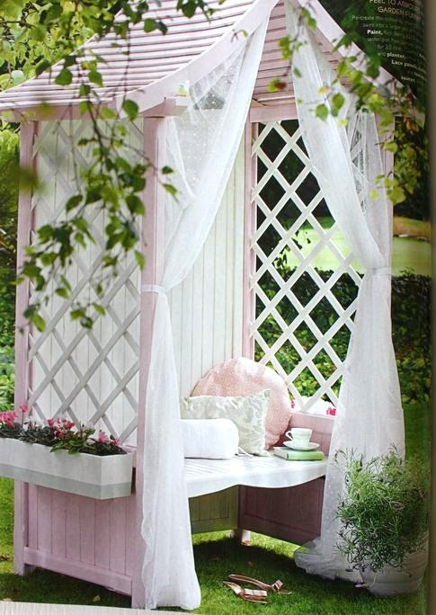 Garden arbor bench painted pink and softened by sheer curtains - lovely!