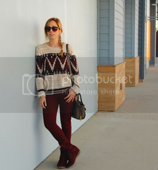 LA fashion blogger The Key To Chic wears a Forever 21 festive folk sweater with corduroy jeans, a Phillip Lim for Target taupe mini satchel, and Xhilaration Kahsha wedge sneakers.