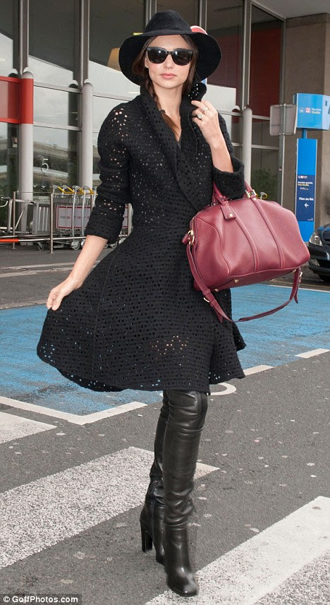 Catwalk ready! Miranda Kerr arrives in Paris today and looks already runway ready as she shows off her chic outfit