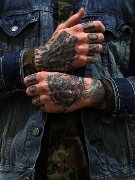 powerful hand tattoo designs