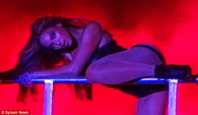 Racy: Beyonce turns up the heat in a bathing suit with the buttocks cut out...