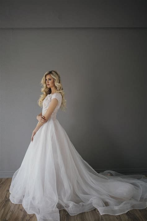 25  best ideas about Modest Wedding Gowns on Pinterest