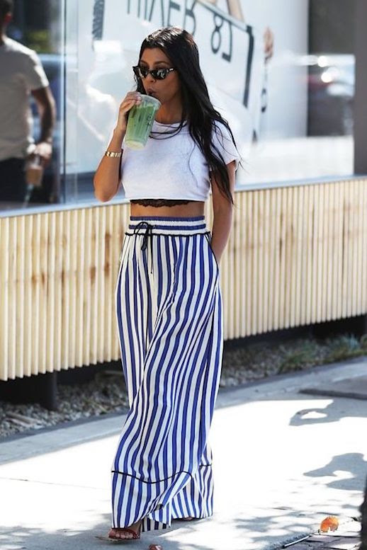 Le Fashion Blog Kourtney Kardashian White Cropped T Shirt Silk Palazzo Wide Leg Pants Via Harpers Bazaar