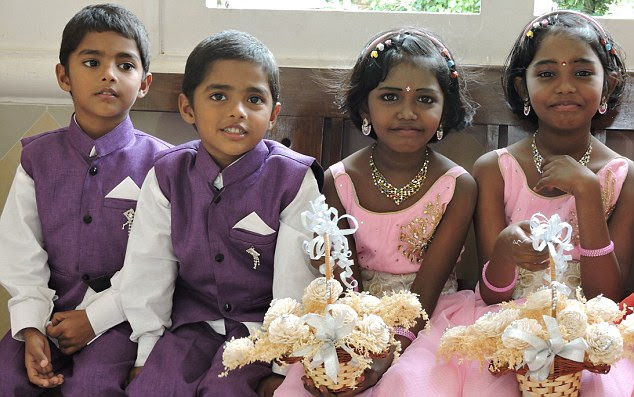 Mirror images: Their wedding was an all twin affair with not only the bride and groom, but flower girls Ansa, Asna and page boys Henry and Hendri specially chosen because they are twins too