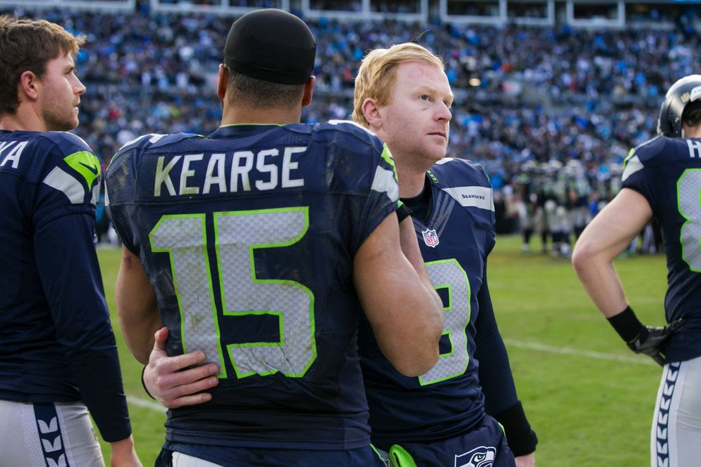 Seahawks wide receiver Jermaine Kearse gives a hug to punter Jon Ryan in the final minute as the Seattle Seahawks lost to the Panthers. (Bettina Hansen / The Seattle Times)