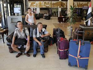 Chinese workers who fled from Samarra, Iraq, wait for …