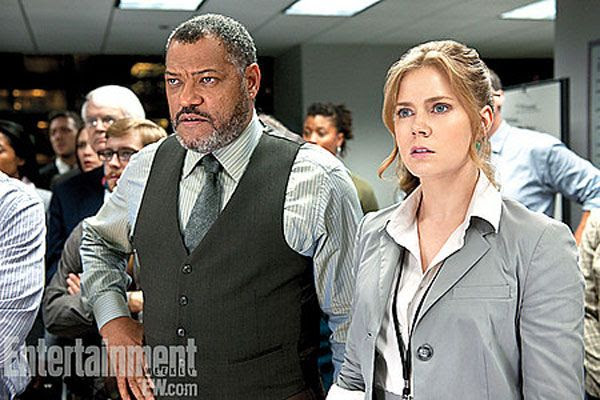 Lois Lane (Amy Adams ) and Perry White (Laurence Fishburne) work for the Daily Planet in MAN OF STEEL.