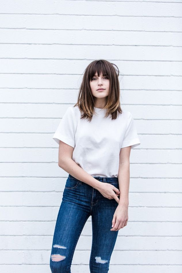 Le Fashion Blog Long Bob Bangs White Boxy Short Sleeve Top High Waisted Ripped Jeans Via Fire On The Head Blogger Rima Vaidila photo Le-Fashion-Blog-Long-Bob-Bangs-White-Boxy-Short-Sleeve-Top-High-Waisted-Ripped-Jeans-Via-Fire-On-The-Head.jpg