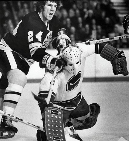 OReilly Bruins Gary Smith photo OReilly Bruins cross check Gary Smith.jpg
