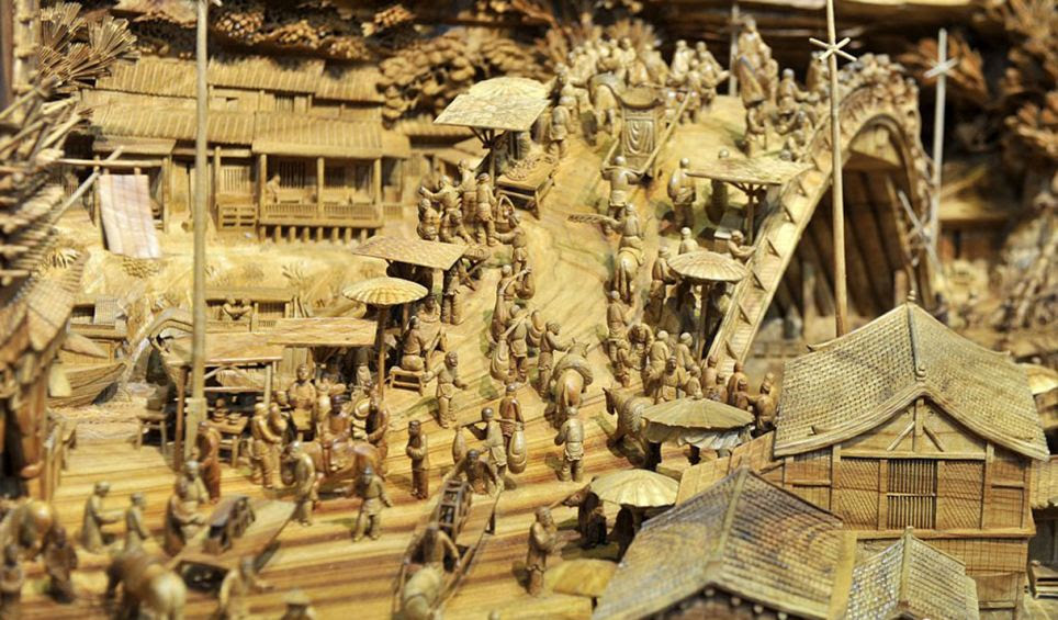 The artwork features buildings, boats, bridges and 550 individually carved people who are shown herding animals, carrying cargo shopping in markets and going about their daily business in a snapshot of ancient Chinese life