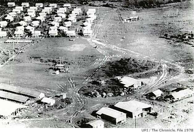 November 28, 1978 - This aerial view of  the Jonestown agricultural commune shows the layout of the tin-roofed buildings that made up the settlement whose members died in a mass suicide-murder on November 19, 1978. At lower left is flat-pitched roof of the death pavilion and beside it are two long canvas-roofed school buildings. In lower right foreground are vehicle and equipment sheds. In the upper left corner are the wooden buildings of the older members of the commune and extensive agricultural plantings are beyond them to the edge of the jungle clearing. This photo was made on November 27, 1978, after the bodies had been removed.UPI/ San Francisco Chronicle File 1978 Photo: UPI, The Chronicle, File 1978