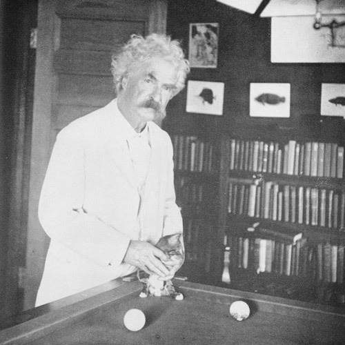 Mark Twain shooting pool with his kitty. They get their hair done in the same place.